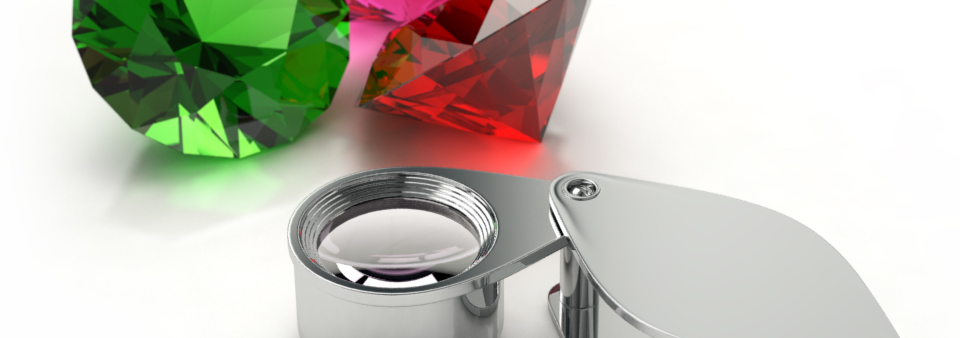 Gem stones and jeweller\'s loupe for ad campaign